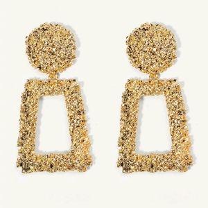 Gold tone textured drop dangle pierced earrings